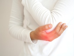 gout and office syndrome,including lupus and lyme disease in woman and she use hand touching on her elbow and symptoms of pain and suffering use for health care and medicine product concept.