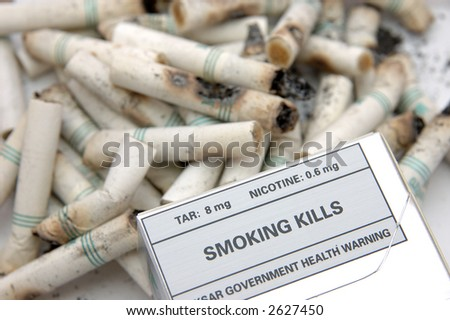 Government warning message: Smoking Kills, in cigarette butts background