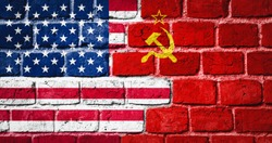 Governments conflict concept. Brick wall colored in USA and USSR flags