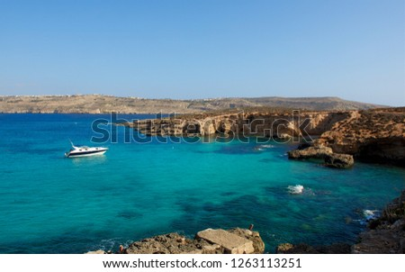 Gozo,Comino island,Maltese coastline with the cliffs,gold rocks over the sea in Malta island with the one yacht in the backround. Malta,Malta view,holiday destination,Maltese maltese coastline