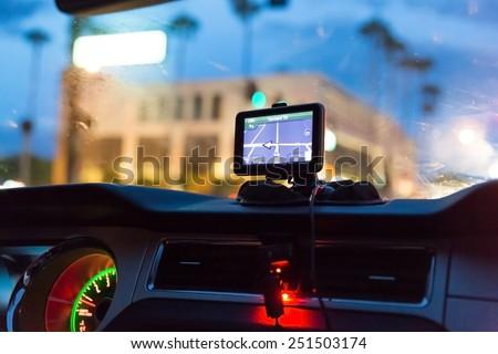GPS device in a car, satellite navigation system Imagine de stoc ©