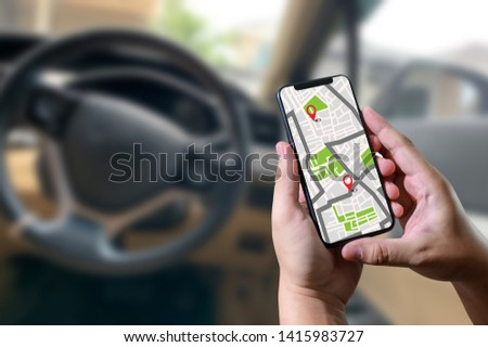 GPS Map to Route Destination network connection Location Street Map with GPS Icons Navigation app car in city concept #1415983727