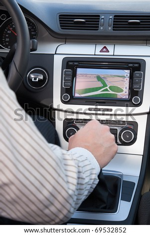 GPS navigation in interior of modern car, driver shifting the gear