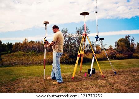 GPS survey - land surveyor in the field