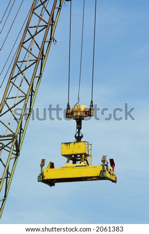 Grab of a large crane, ready to pick up containers at Antwerp harbor