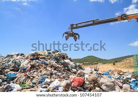 Grabber crane working in landfill