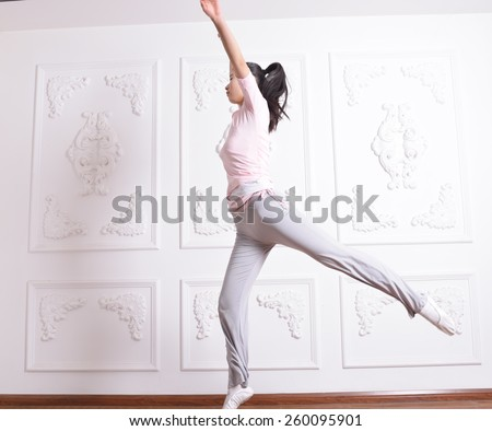 Grace young girl jumping exercises in Studio