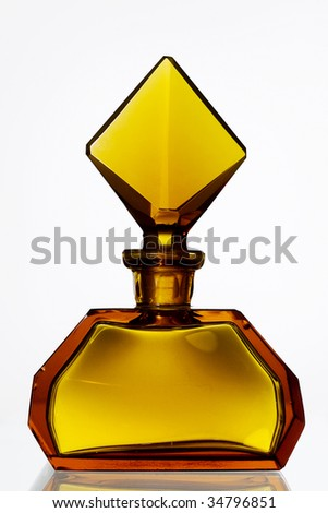 Graceful antique perfume bottle made of amber glass