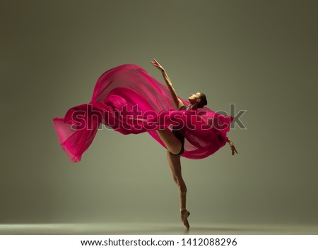 Graceful ballet dancer or classic ballerina dancing isolated on grey studio background. Woman with the pink silk cloth. The dance, grace, artist, contemporary, movement, action and motion concept. Foto stock ©