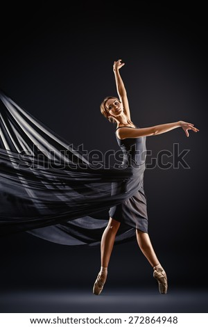 Graceful beautiful ballet dancer posing at studio. Art concept.