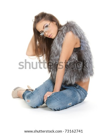 Graceful brunette in jeans and fur