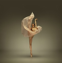 Graceful classic ballerina dancing, posing isolated on grey studio background. Tender beige cloth. The grace, artist, movement, action and motion concept. Looks weightless, flexible. Fashion, style.