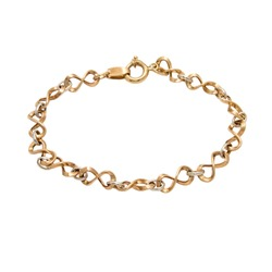 Graceful golden bracelet from white and yellow gold isolated on white background