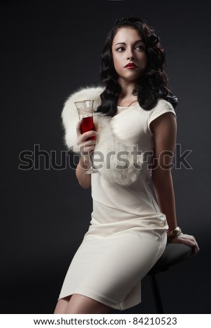 graceful woman holding glass of wine. retro portrait