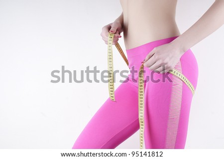 Graceful  woman  measuring perfect shape of beautiful hips. Healthy lifestyles concept