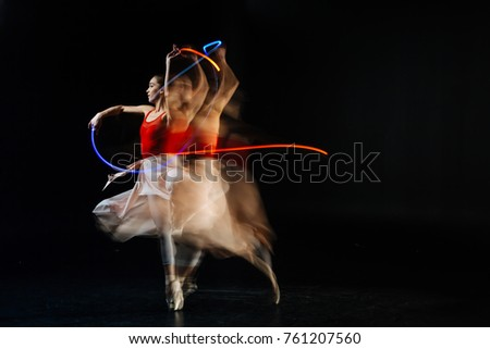 Gracious movements. Professional elegant female dancer moving her hands and dancing while performing on stage #761207560