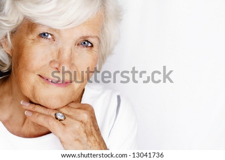 Gracious senior lady portrait on white background - stock photo