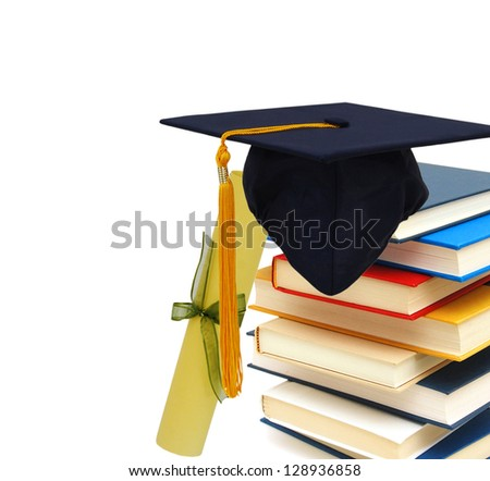 Grad hat and diploma with books isolated on white