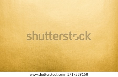 Gradation gold foil leaf shiny with sparkle yellow metallic texture background. Abstract paper glitter golden glossy for template. top view.