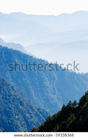 Gradation mountains with light fog in the morning