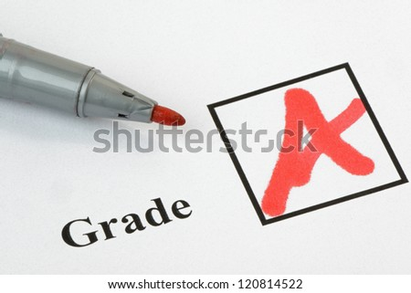 Grade A written on an exam paper, with pen. 36 mp image