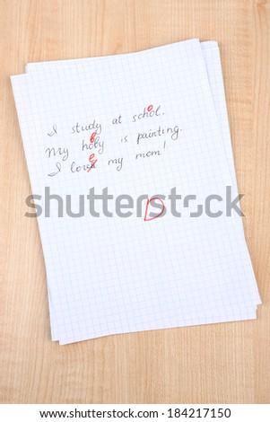 Grade written on an exam paper, close-up