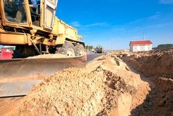 Grader machine during roadworks for asphalt paving