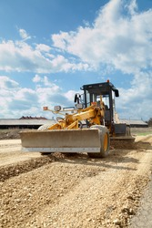 Grader working at road construction site