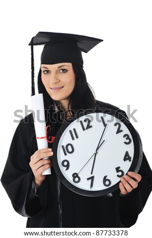 Graduate girl student in gown with diploma and clock