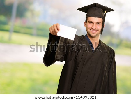 Graduate Man Holding Blank Card, Outdoor