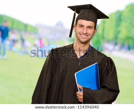 Graduate Man Holding Book, Outdoor