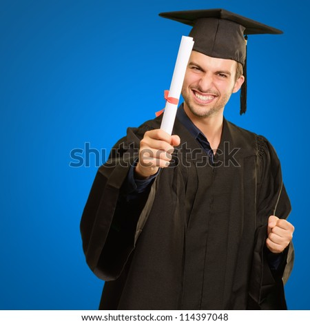 Graduate Man Holding Degree Isolated On Blue Background