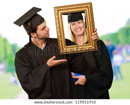 Graduate Man Holding Frame, Outdoor
