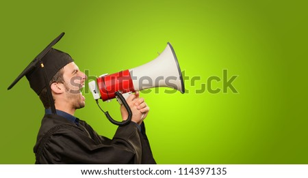 Graduate Man Holding Megaphone On Green Background