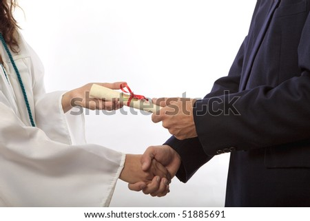 graduate receiving her diploma and a handshake