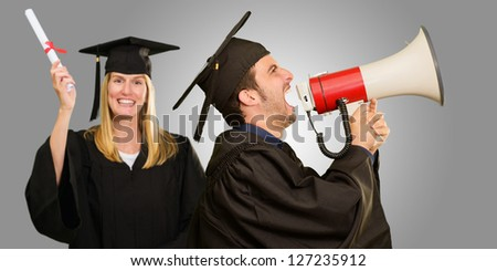 Graduate Student Holding Megaphone And Certificate On Gray Background