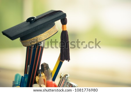Graduate study or Education knowledge is power concept: Graduated cap Put on color pencil in basket. Conceptual for Educational is successs study or business world. Back to School ideas.