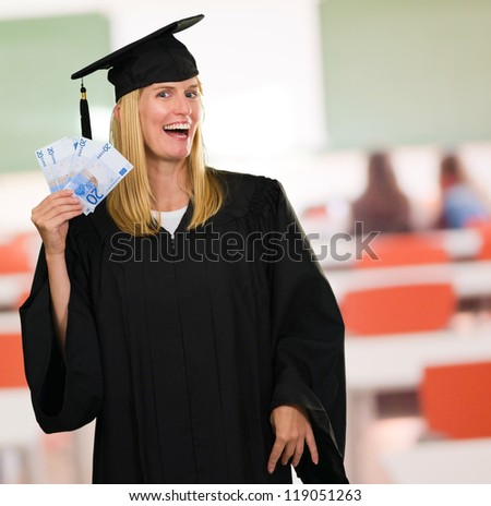 Graduate Woman Holding Euro Currency at a classroom