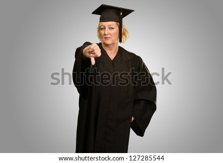 Graduate Woman Showing Thumb Down Sign On Grey Background