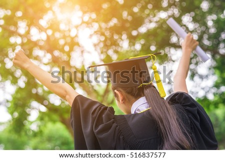 Graduate woman students wearing graduation hat and gown  #516837577