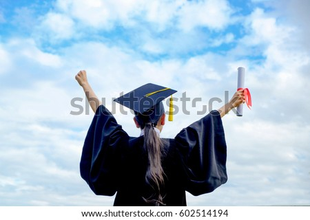 Graduate woman students wearing graduation hat and gown, back view of graduate student girl hug future and look up to copy space, she wear graduation cap and gown ,asian woman