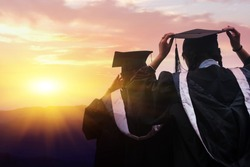 Graduates face the morning sun