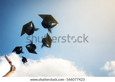 graduates hands throwing...