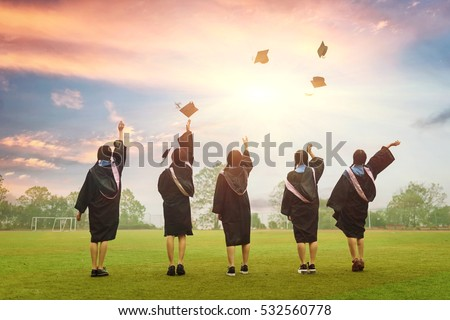 graduates throwing graduation hats in the air. #532560778