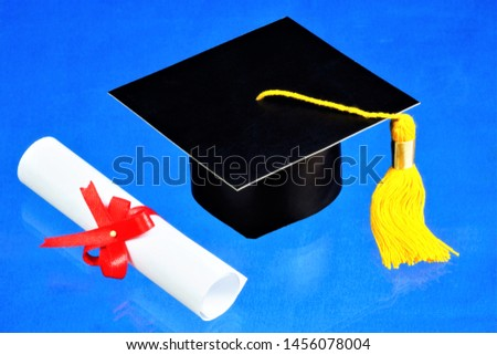 Graduation academic cap and diploma scroll. Traditional graduation ceremony in schools, colleges, universities.