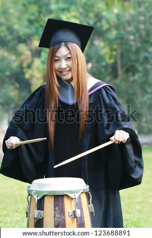 graduation asia women with degree suit play drum