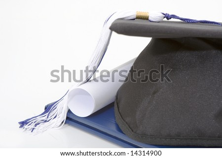 graduation cap and diploma isolated against white background