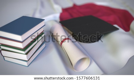Graduation cap, books and diploma on the Japanese flag. Higher education in Japan related conceptual 3D rendering ストックフォト ©