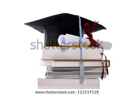 Graduation cap, books, and scroll isolated over white background - stock photo