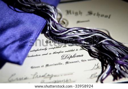 graduation cap, diploma and tassel